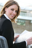 Pretty Business Woman with Newspaper Royalty Free Stock Image