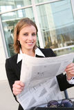Pretty Business Woman with Newspaper Royalty Free Stock Photography
