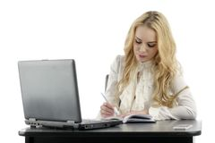 Pretty business woman with notebook in the office Royalty Free Stock Photos