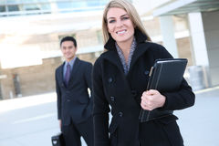 Pretty Business Woman at Office. A pretty business woman walking to work at the office building stock photos