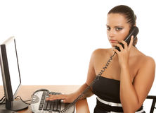 Pretty business woman at office desk with a white Stock Photography