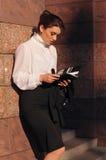 Pretty business woman portrait near wall Stock Photo