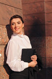 Pretty business woman portrait near wall Royalty Free Stock Image
