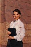 Pretty business woman portrait near wall Royalty Free Stock Photo