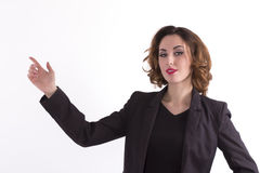 Pretty business woman presenting a copyspace Stock Photography
