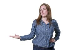 Pretty business woman presenting something over white background.  Royalty Free Stock Photos