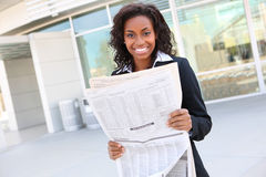 Pretty Business Woman Reading Newspaper Royalty Free Stock Image