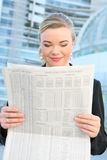 Pretty Business Woman Reading Newspaper Stock Photo