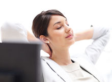 Pretty business woman resting at her desk Royalty Free Stock Photography