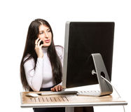 Pretty business woman sitting in front of computer Stock Photo
