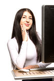 Pretty business woman sitting in front of computer Royalty Free Stock Images