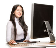 Pretty business woman sitting in front of computer Royalty Free Stock Photos