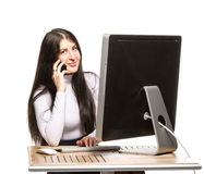 Pretty business woman sitting in front of computer Royalty Free Stock Photography
