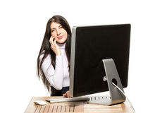 Pretty business woman sitting in front of computer Stock Image