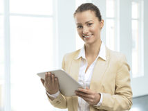 Pretty business woman smiling confidently Stock Photo