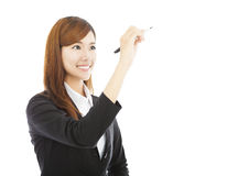 Pretty business woman standing and holding a pencil Stock Photography