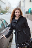 Pretty business woman standing near the vehicle Royalty Free Stock Image