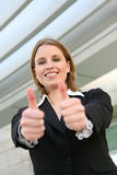 Pretty  Business Woman Success. A young blonde business woman with her thumbs up Stock Photo
