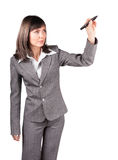 Pretty business woman in suit drawing a graph or anything else on empty white background Stock Photography