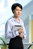 Pretty business woman with tablet Stock Photography