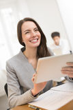 Pretty Business woman with tablet pc computer in office Stock Photos