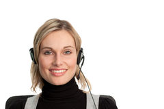 Pretty business woman talking on headset. Attractive Businesswoman talking on helpdesk Royalty Free Stock Photo