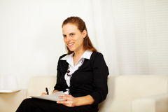 Pretty business woman working at home Royalty Free Stock Images