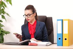 Pretty business woman working in the office Stock Photos