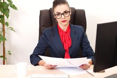 Pretty business woman working in the office Stock Image