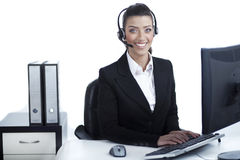 Pretty business woman working at office Royalty Free Stock Image