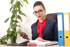 Pretty business woman working in the office Royalty Free Stock Image