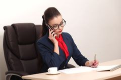 Pretty business woman working in the office Stock Photography