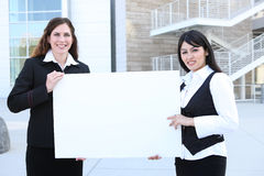 Pretty Business Women Holding Sign Royalty Free Stock Image