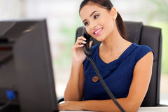 Businesswoman answering telephone Royalty Free Stock Image