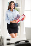 Pretty Businesswoman With Binder Royalty Free Stock Images