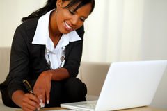 Pretty businesswoman on black suit working Stock Image