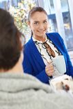 Pretty businesswoman chatting to coworker Stock Photos