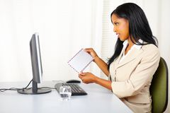 Pretty businesswoman checking the mail Royalty Free Stock Photos