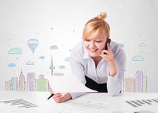 Pretty businesswoman with colorful city sky-scape background Royalty Free Stock Image