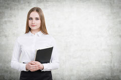 Pretty businesswoman on concrete Royalty Free Stock Photography
