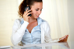 Pretty businesswoman conversing on cellphone Royalty Free Stock Photos