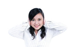 Pretty businesswoman covering ears with her hands royalty free stock photo