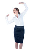 Pretty businesswoman dancing and cheering Stock Images