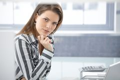 Pretty businesswoman at desk Royalty Free Stock Image