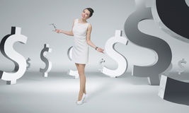Pretty businesswoman among dollar signs Stock Images
