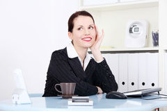 Pretty businesswoman dreaming in the office. Stock Photography