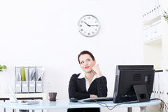Pretty businesswoman dreaming in the office. Royalty Free Stock Photo
