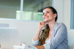 Pretty businesswoman dreaming Royalty Free Stock Image