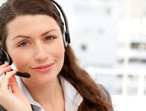 Pretty businesswoman with earpiece smiling Stock Photo