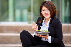 Pretty businesswoman eating healthy Stock Photos